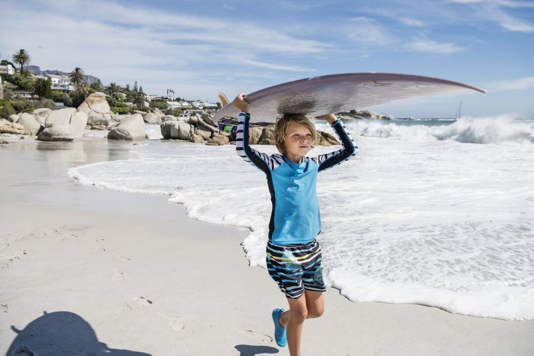 536500c_madagaskar_532195_cancun_569418_adapt_boy_going_surfing.jpg